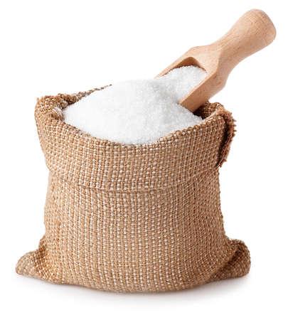 Foto de sugar with scoop in burlap sack isolated on white background. - Imagen libre de derechos