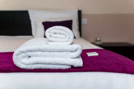 Photo for Close-up clean towels and soap in hotel room - Royalty Free Image