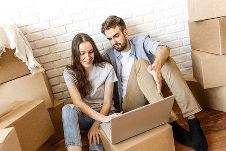 Foto de Young couple surfing laptop while moving - Imagen libre de derechos