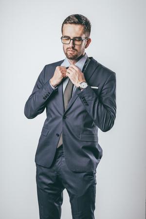 Foto de Elegant businessman tying necktie - Imagen libre de derechos