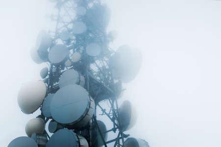 Photo pour telecommunications tower into the clouds - image libre de droit