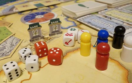 Foto de Games and dices, playcards, figurines and symbols. Casual leisure gaming. - Imagen libre de derechos