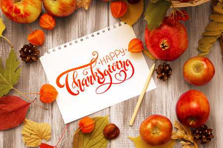 Photo for Thanksgiving - letters. Autumn bright background. Flowers, leaves and fruits on a blue wooden background. Background for the autumn holidays and thanksgiving day. - Royalty Free Image