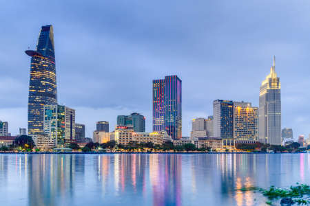 Photo for HO CHI MINH CITY, SAIGON/VIETNAM - CIRCA AUGUST 2015: Lights of Saigon downtown skyline are reflected in the river - Royalty Free Image