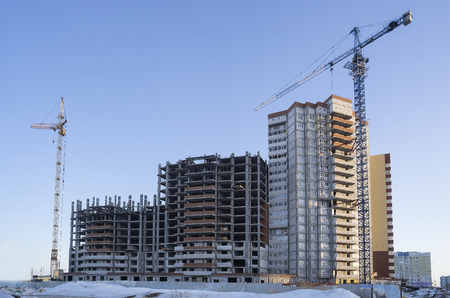 Photo for Two lifting crane and building under construction - Royalty Free Image