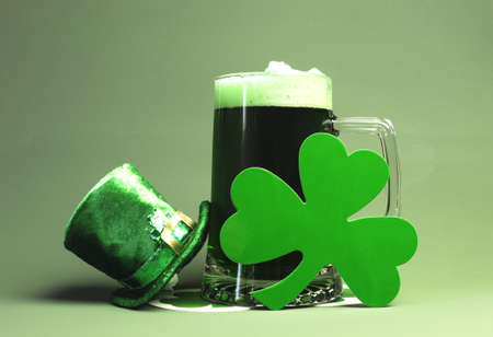 Photo for Happy St Patricks Day with glass stein of green beer, leprechaun hat and shamrock  - Royalty Free Image