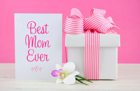 Photo for Happy Mothers Day pink and white gift with Best Mom Ever greeting card, on white shabby chic distressed wood table. - Royalty Free Image