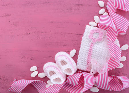Photo pour Its a Girl Baby Shower or Nursery background with baby clothes and accessories with copy space for your text here. - image libre de droit