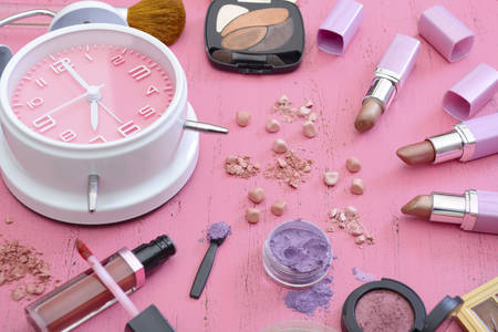 Photo pour Early morning makeup routine and products on vintage shabby chic pink wood table. - image libre de droit