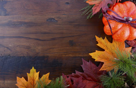 Photo for Autumn Fall background for Thanksgiving or Halloween with leaves and decorations on rustic wood table with copy space for your text here. - Royalty Free Image