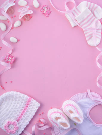 Photo for Its a Girl pink theme Baby Shower or Nursery background with decorated borders on pink wood background. - Royalty Free Image