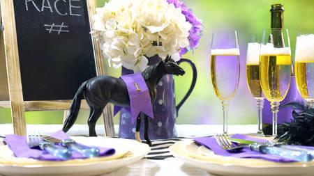 Photo pour Horse racing Racing Day Luncheon fine dining table setting with small black fascinator hat, decorations and champagne. - image libre de droit