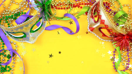 Foto de Mardi Gras overhead background with colorful masks and beads on rustic yellow wood background, with copy space. - Imagen libre de derechos