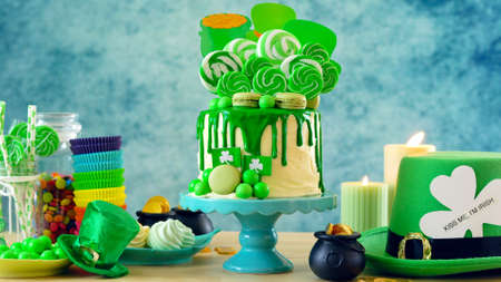 Photo for St Patrick's Day theme candyland novelty drip cake and party table. - Royalty Free Image