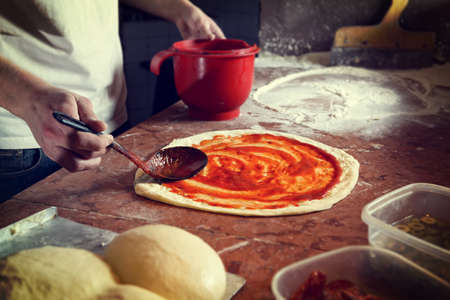 Photo for Fresh original Italian raw pizza, preparation in traditional style. - Royalty Free Image