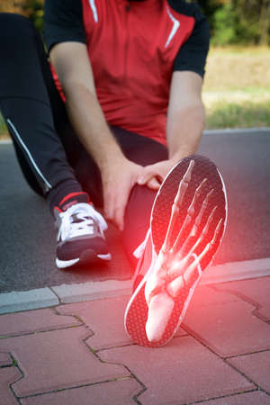 Foto de Man runner outside with digital composite of foot bones - Imagen libre de derechos
