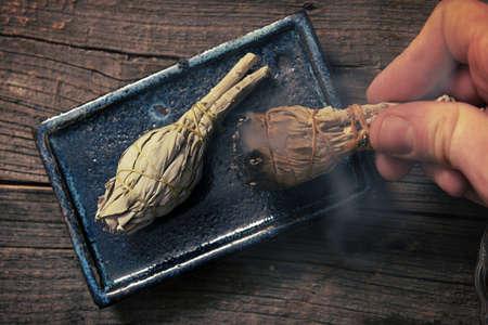 Foto de Man's hand with burning natural white sage incense - Imagen libre de derechos