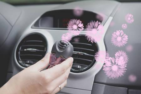 Photo pour Car air freshner mounted to ventilation panel, fresh flower scent  - image libre de droit