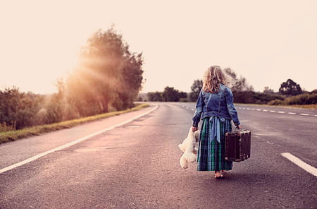 Photo for 	Escape from the house - a little girl with a suitcase and a toy - Royalty Free Image