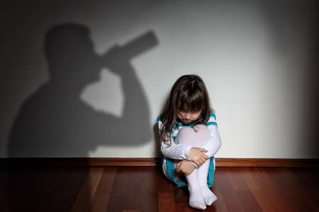 Foto de Alcohol at home - rejected sad child - Imagen libre de derechos