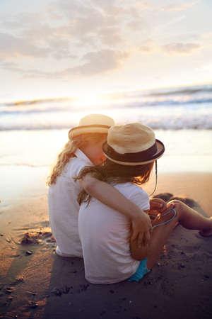 Summer adventure - two girls huddled outside