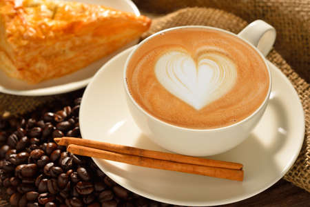 Foto für A cup of cafe latte with coffee beans and puff pastry - Lizenzfreies Bild