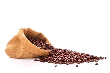 Foto de Coffee beans in bag isolated on white - Imagen libre de derechos