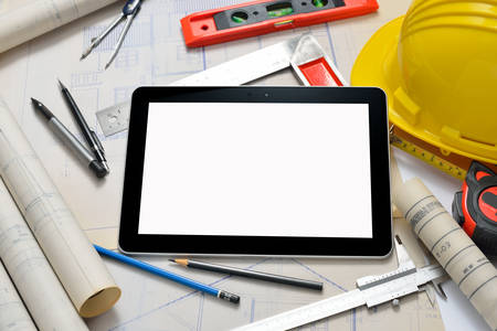 Photo pour Tablet computer with architectture and construction tools and blueprints - image libre de droit