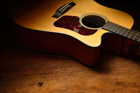Photo for Acoustic guitar on old wooden background - Royalty Free Image