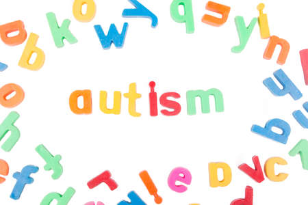 Foto de Autism text with scattered alphabets isolated on a white background. - Imagen libre de derechos