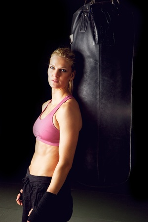 Vertical portrait of a young beautiful female boxer