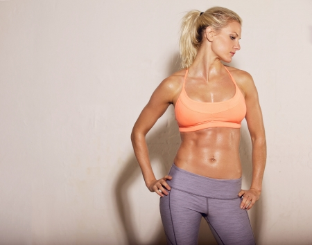 Photo for Confident athletic woman with sixpack abs posing - Royalty Free Image