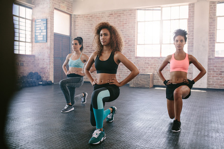 Photo for Portrait of young women exercising in aerobics class. Three females doing workout together in gym. - Royalty Free Image
