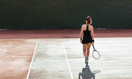 Photo pour Full length rear view of female tennis player on the court. Sports woman playing on tennis court. - image libre de droit