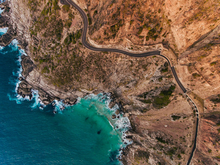 Photo for Aerial view of road going through beautiful landscape. Rocky scenery close to the ocean. - Royalty Free Image
