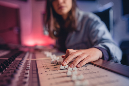 Photo for Woman hands mixing audio in recording studio. Female hands working on music mixer. Music production technology. - Royalty Free Image