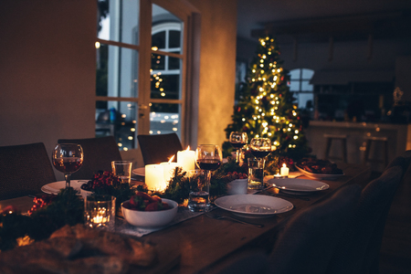 Photo pour Specially decorated christmas table at home for dinner. Beautifully set dining table for Christmas Eve. - image libre de droit