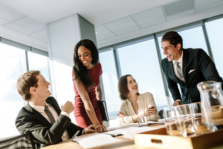 Photo pour Group of diverse business people smiling during a meeting in office. Happy business colleagues laughing in a meeting in conference room. - image libre de droit