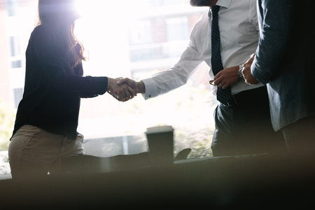 Photo for Business associates shaking hands after a deal in meeting. Business people hand shake and greeting each other after an agreement. - Royalty Free Image