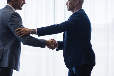 Photo for Businessmen hand shake after a deal in office. Businesspeople shaking hands and making an agreement. - Royalty Free Image