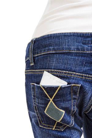 Foto de Condom  in the back pocket of blue jeans on white background - Imagen libre de derechos