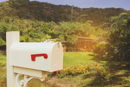 Foto de vintage mail box on country home. - Imagen libre de derechos