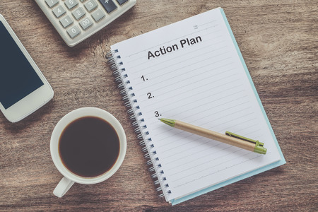 Photo pour Action Plan text on book note with cup of coffee, pen. - image libre de droit