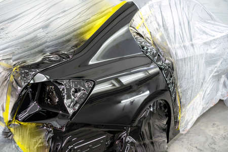 Foto de Car body after painting in a cars spray booth. - Imagen libre de derechos