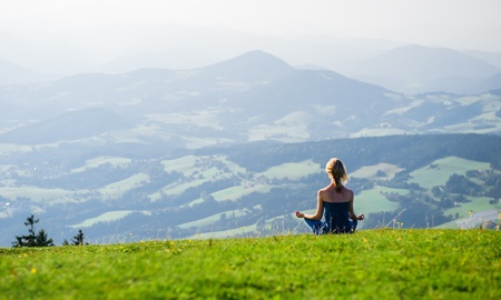 Photo for Young woman meditating outdoors - Royalty Free Image