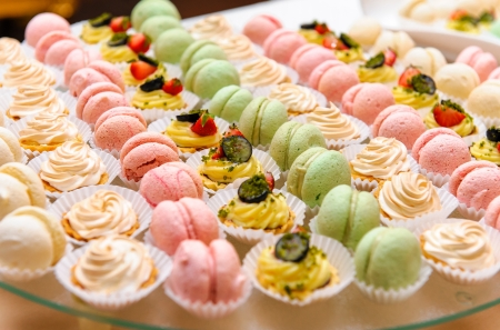 Tray with delicious cakes and macaroon