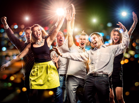 Photo for Cheerful group of young people dancing at party - Royalty Free Image