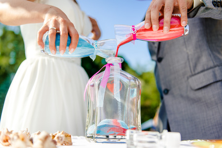 Photo for Newlyweds during sand ceremony - Royalty Free Image