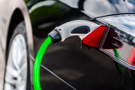 Photo pour Electric car charging in EV charging station - image libre de droit