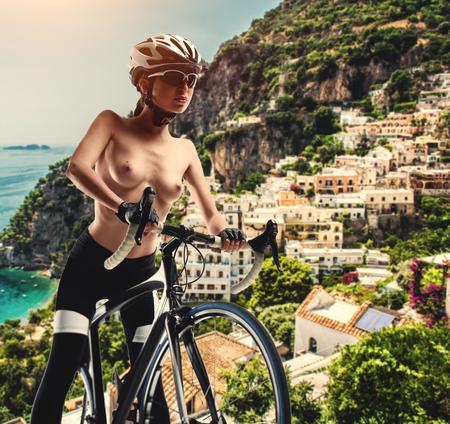 Foto de Naked woman with a bicycle against Amalfi coast. Italy - Imagen libre de derechos